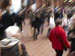 Motion blurred - travelling people
