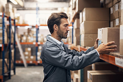 Buy stock photo Shot of a young man working in a warehouse
