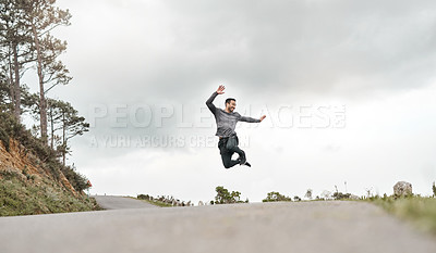 Buy stock photo Full length shot of a handsome young man jumping for joy after his morning run outdoors