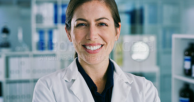 Buy stock photo Portrait of a young woman standing in a lab