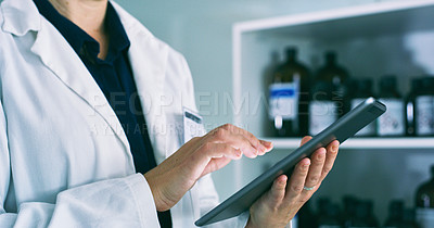 Buy stock photo Closeup shot of an unrecognisable woman using a digital tablet in a lab