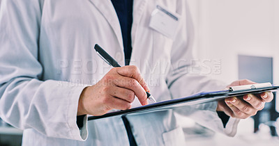 Buy stock photo Closeup shot of an unrecognisable woman writing notes on a clipboard in a lab