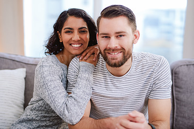 Buy stock photo Cropped portrait of a happy young couple enjoying a relaxing day at home together