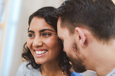 Buy stock photo Cropped shot of a happy young couple sharing an intimate moment together during a relaxing day at home
