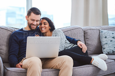 Buy stock photo Cropped shot of a happy young couple enjoying a relaxing day at home together