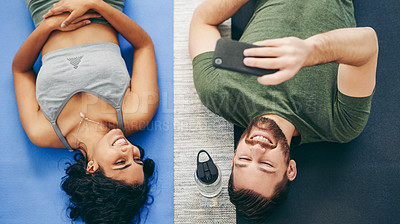 Buy stock photo Cropped shot of a young couple taking a selfie while wearing exercise clothes