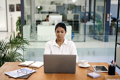 Buy stock photo Shot of a mature businesswoman working on a laptop in an office