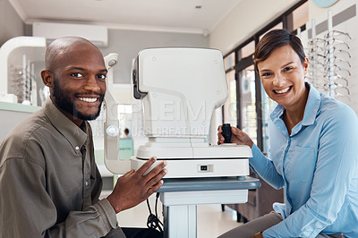 Buy stock photo Shot of an optometrist examining her patient's eyes with an autorefractor