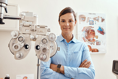 Buy stock photo Portrait of a confident woman using an optical refractor in an optometrist's office