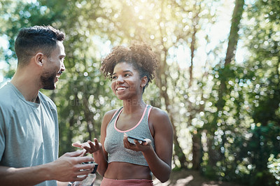 Buy stock photo Shot of two friends laughing and talking before a workout