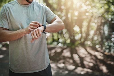 Buy stock photo Shot of an anonymous person checking their sports watch
