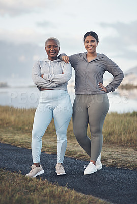 Buy stock photo Shot of two friends out for a workout together
