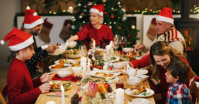 Buy stock photo Shot of a happy family having Christmas lunch together at home
