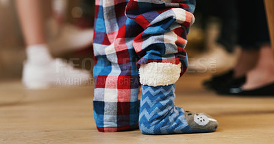 Buy stock photo Shot of an unrecognisable little boy wearing cute fluffy character socks during a Christmas party with family at home
