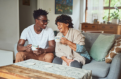 Buy stock photo A grandmother and her grandson enjoying a cup of coffee together at home