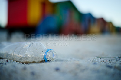 Buy stock photo Shot of bottles laying on the beach