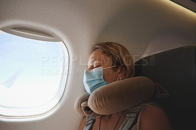 Buy stock photo Shot of a young woman sleeping in the aeroplane