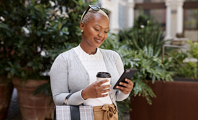 Buy stock photo Shot of a young businesswoman using a cellphone while out in the city