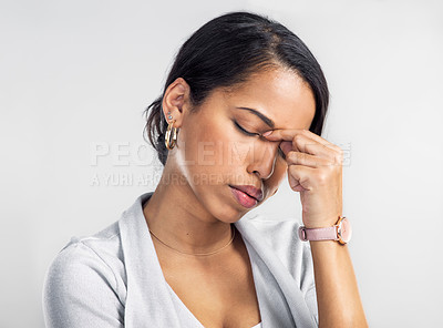 Buy stock photo Studio shot of a young businesswoman looking stressed against a grey background