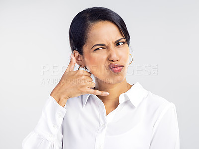 Buy stock photo Studio shot of a young businesswoman receiving an unwanted call against a grey background