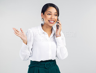 Buy stock photo Studio shot of a young businesswoman using a smartphone against a grey background