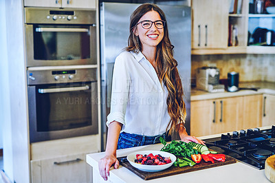 Buy stock photo Portrait of a young woman making a healthy meal at home