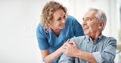 Buy stock photo Shot of a female nurse speaking to one of her elderly patients in a nursing home
