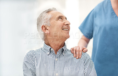 Buy stock photo Shot of an unrecognizable nurse supporting one of their elderly male patients