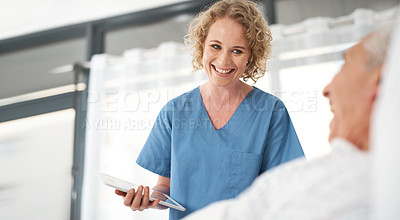 Buy stock photo Shot of a female doctor checking in on one of her elderly male patients in hospital