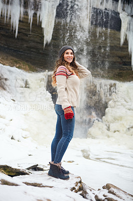 Buy stock photo Full length shot of an attractive young woman spending the day outside during winter