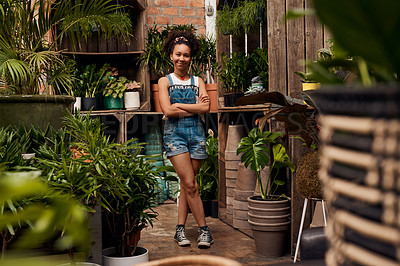 Buy stock photo Portrait of a confident young woman working in a garden centre
