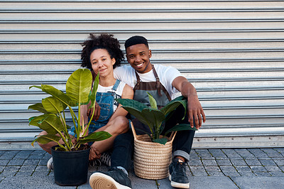 Buy stock photo Portrait of a young man and woman sitting with their plants outside a garden centre