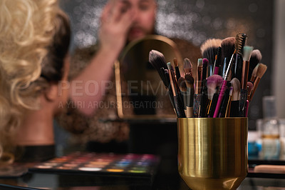 Buy stock photo Shot of an unrecognisable man applying makeup backstage