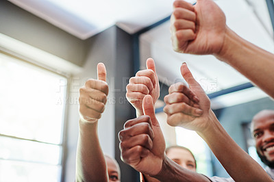 Buy stock photo Low angle shot of a group of businesspeople showing thumbs up