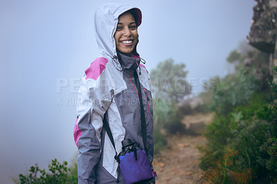 Buy stock photo Cropped portrait of an attractive young woman out for an early morning hike in the mountains