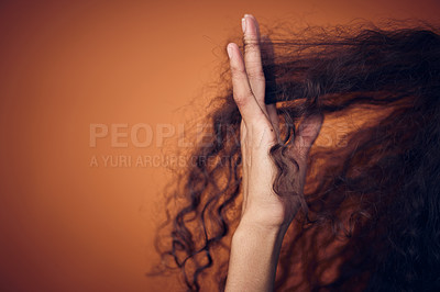 Buy stock photo Cropped shot of a woman running her fingers through her curls