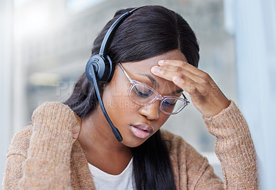 Buy stock photo Shot of a businesswoman suffering with a migraine at her desk in her office