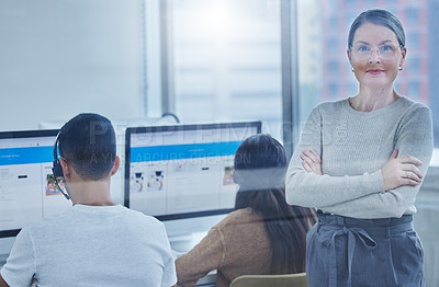 Buy stock photo Shot of a female manager in the office with her staff members