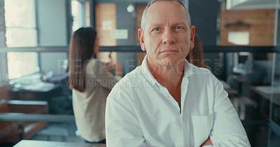 Buy stock photo Shot of a mature businessman sitting in his office