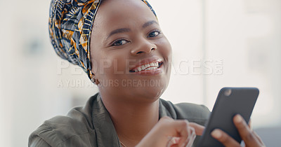 Buy stock photo Portrait of a young woman using a cellphone at home