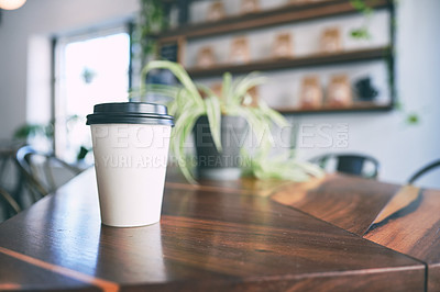 Buy stock photo Shot of a paper cup on a counter in an empty cafe