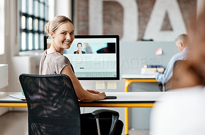 Buy stock photo Shot of an attractive young businesswoman sitting at her desk in the office