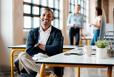 Buy stock photo Portrait of a confident young businessman working in an office