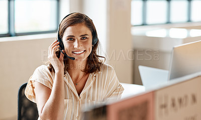 Buy stock photo Portrait of a young businesswoman wearing a headset while working in an office