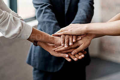 Buy stock photo Closeup shot of a group of unrecognisable businesspeople joining their hands together in a huddle