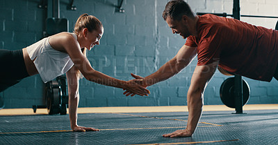 Buy stock photo Shot of two people working out together at the gym