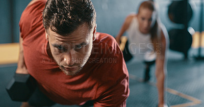 Buy stock photo Shot of a sporty young man working out at the gym