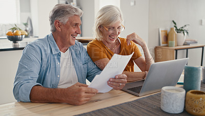 Buy stock photo Shot of a mature couple sitting together at home and using a laptop to calculate their finances