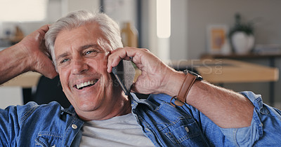 Buy stock photo Shot of a mature man sitting alone on the sofa at home and using his cellphone