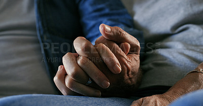 Buy stock photo Cropped shot of an unrecognizable couple sitting alone at home and holding hands